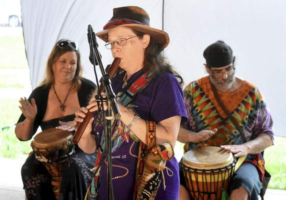 Ginger Karns and her native American flute joins drummers during a performance at RiverDrums 2017 at Headwaters Park on Sunday. The festival celebrates the city's rivers and cultural diversity with art, dance and drums. (Photos by Samuel Hoffman | The Journal Gazette)