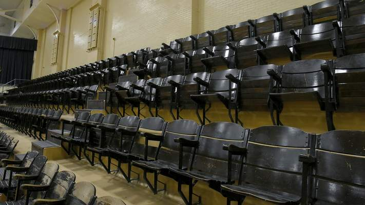Wooden seats line a gymnasium on the former GE campus, the subject of a $300 million project.