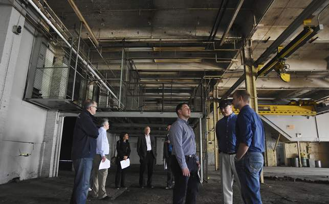 Rachel Von | The Journal Gazette Guests check out the architecture in Building 22 during a Greater Fort Wayne Inc. tour through six buildings on the GE campus on May 26.
