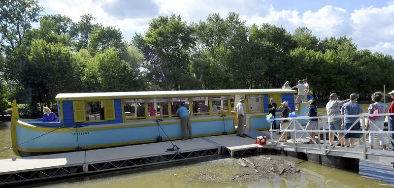 Guests check out the Sweet Breeze, an 1840s replica canal boat that will host tours and parties on the city's rivers, during a christening event Tuesday at Headwaters Park West. (Photos by Rachel Von | The Journal Gazette)