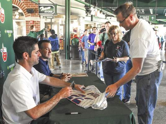 Jeff Koch of Fort Wayne gets a shirt signed by Mark Prior on Wednesday evening at Parkview Field. Koch said he's a big fan of Prior's and has had the shirt since 2004. (Michelle Davies | The Journal Gazette)