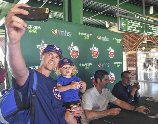 Michelle Davies | The Journal Gazette Keegan Laycock of Fort Wayne takes a selfie with his son Paxton, 2, with Mark Prior behind him. The former Cubs ace was at Parkview Field signing autographs Wednesday before the TinCaps game.