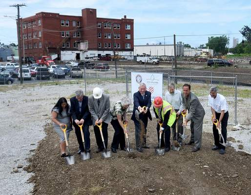 Samuel Hoffman | The Journal Gazette  Mayor Tom Henry, center, leads the first ceremonial groundbreaking for the Three Rivers Protection and Overflow Reduction Tunnel (3RPORT) Thursday at Glasgow and Dwenger avenues.