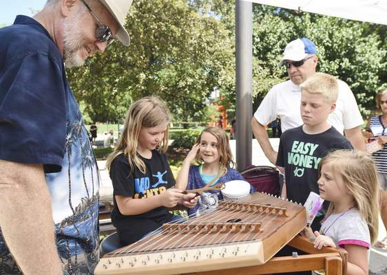 Michelle Davies | The Journal Gazette Among Make Music Day activities on Wednesday will be introductions of instruments to the public such as the dulcimer.