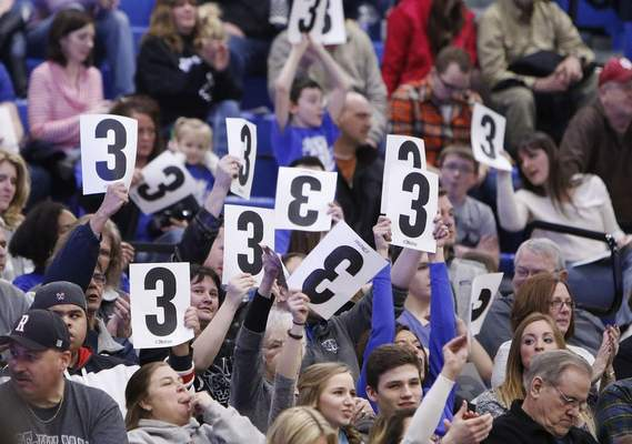 FILE: IPFW fans hold up 3 signs in celebration of Max Landis, who led Division I in 3-point percentage at 50 percent.