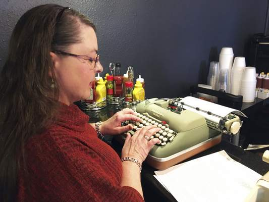Andrea Kittle tries out a vintage Smith Corona electric typewriter. Aficionados are hunting for the machines in thrift stores, online auction sites and antique shops.