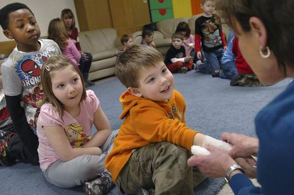FILE: A St. Joseph Regional Burn and Wound Center nurse bandages a youth during a lesson at First Presbyterian Day School Ministry on how to avoid getting burned by hot objects.