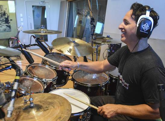 Nick D'Virgilio works on a recording at Sweetwater Sound, where the long-time drummer has worked since 2014. (Michelle Davies | The Journal Gazette)