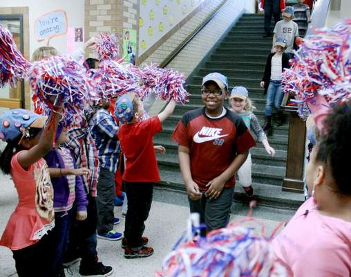 FILE: Students cheer on third- through fifth-graders at an ISTEP+ pep rally at Irwin Elementary School.