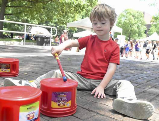 Michelle Davies | The Journal Gazette Max Watson, 4, of Fort Wayne plays the drums using old coffee containers at the Dumpster Drummers area Wednesday during the annual Make Music Day at Freimann Square.