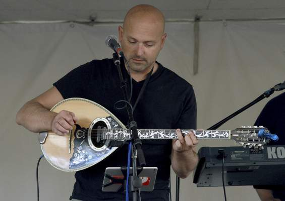 Lee Nourtsis of the band Lazaros performs on a bouzouki Sunday afternoon.