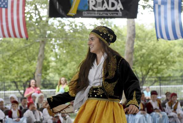 Alexia Skembos, 17, of the dance group Meraklides performs a traditional Greek dance.