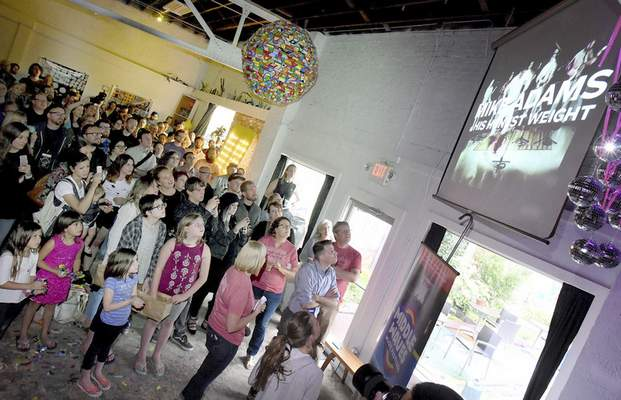 About 100 people were on hand Monday at Wunderkammer Company for the announcement of this year's lineup of for the Middle Waves Music Festival, Sept. 15 and 16 at Headwaters Park. (Samuel Hoffman | The Journal Gazette)