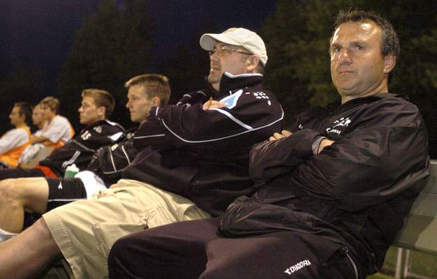 Fort Wayne Fever head coach Bobby Poursanidis (right) watches his team during the game against the Indiana Invaders on Wednesday evening.