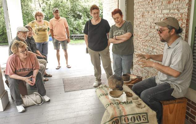Michelle Davies   The Journal Gazette Presenter Erik Vosteen explains how Miami Indians would have made their cooking vessels during Saturday's Miami Indian Heritage Days at the Chief Richardville House.