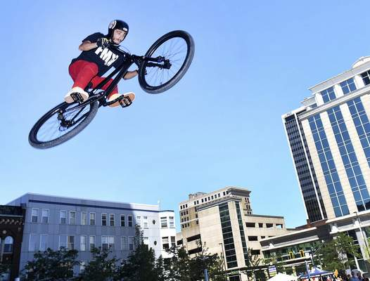Photos by Samuel Hoffman | The Journal Gazette Brandon Wolferman soars over I&M Plaza as he and other bikers from the Fort Wayne Indoor Skate Park show off their BMX skills in the Open Streets Fort Wayne on Sunday.