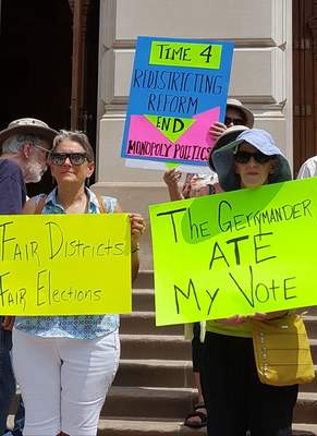 About 100 Hoosiers attended a rally for districting reform Monday outside the Statehouse. (Niki Kelly | The Journal Gazette)