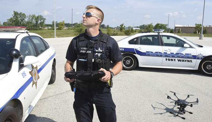 Cathie Rowand | The Journal Gazette Fort Wayne Police officer Mike Hickman demonstrates a new Air Support Unit. FWPD purchased two Typhoon H-Pro with Real Sense Drones that will be put in service to assist the officers. Four officers will go through training to certify them through the FAA as Remote Pilot-In-Command officers.