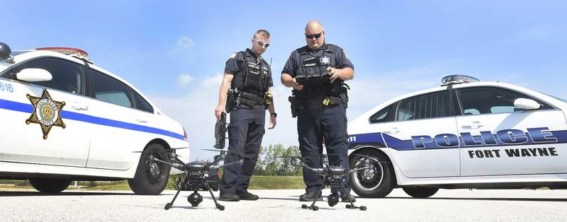 Cathie Rowand | The Journal Gazette Fort Wayne Police officers Mike Hickman, left, and James Rowland prepare to demonstrate a new Air Support Unit. FWPD purchased two Typhoon H-Pro with Real Sense Drones that will be put in service to assist the officers. Four officers will go through training to certify them through the FAA as Remote Pilot-In-Command officers.