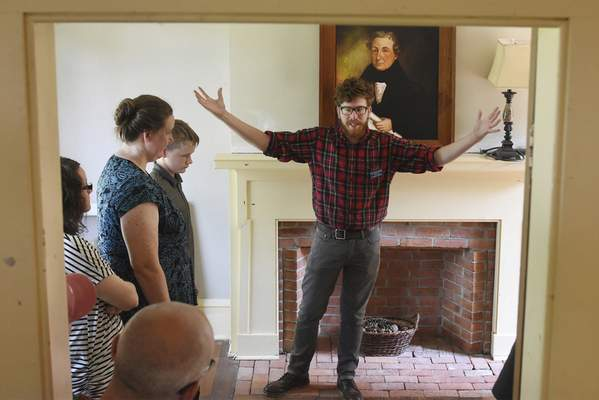 Photos by Rachel Von | The Journal Gazette The History Center's Zach Arnett talks Saturday during a tour of the Chief Richardville House. Visitors gathered at the Bluffton Road site for Miami Indian Heritage Days, a monthly event meant to expose area residents to the history of the Miami tribe.