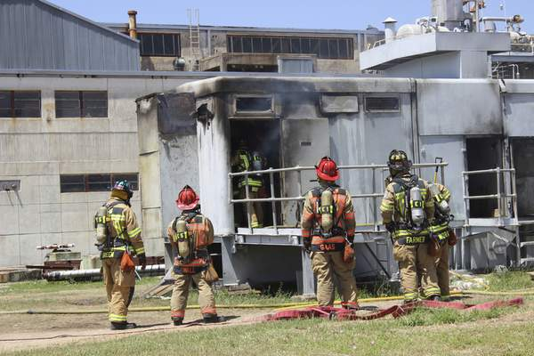 Associated Press In this photo provided by the Bryan, Texas, Fire Department, firefighters stand outside the city power plant after an explosion and fire in April 2014 that left 60-year-old worker Earle Robinson dead.