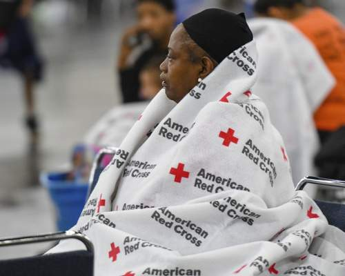 An evacuee rests at the George R. Brown Convention Center in Houston, Monday, Aug. 28, 2017. (Scott Clause/The Daily Advertiser via AP)