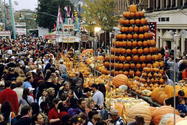 TourismOhio Pumpkins are shaped like a tree amid crowds at the Circleville Pumpkin Show in Circleville, Ohio, which attracts tens of thousands of people.