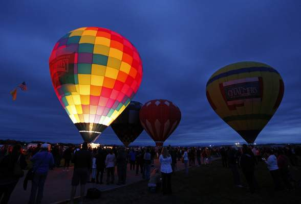Associated Press Spectators watch as hot air balloons are prepared for their lift off during the 44th International Balloon Fiesta in Albuquerque, N.M.