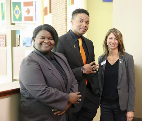 From left, Chilinda Cobb and Cameron Owens show off their academic rings with Indiana Tech's National Society of Black Engineers chapter faculty adviser Susan McGrade.