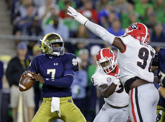 Associated Press photos Notre Dame quarterback Brandon Wimbush completed 20 of 40 passes last week for 210 yards. Today, he faces Boston College.
