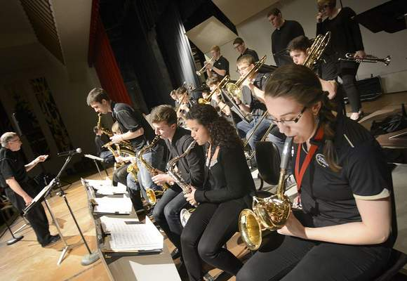 FILE: Stephanie Klunk, far right, plays saxophone for the Purdue Jazz Band under the direction of Mo Trout, far left.