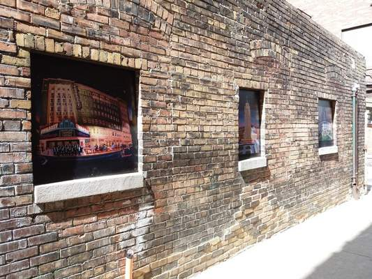Corey McMaken | The Journal Gazette Pieces of art are inset in the alleyconnecting Washington Boulevard to Wayne Street between Thirsty Camel and Double Dragon.