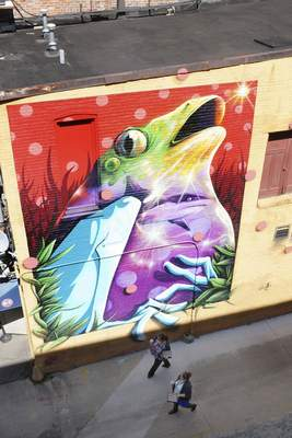 Mike Moore | The Journal Gazette The wall mural on display in the alley next to 816 Pint & Slice downtown towers above those walking past. Art this Way is planning projects of this scale.