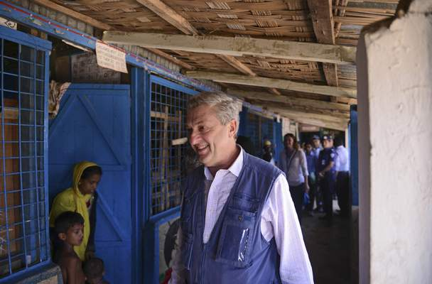 United Nations High Commissioner for Refugees Filippo Grandi visits a school that has been turned to a temporary camp for newly arrived Rohingya Muslims at Kutupalong, Bangladesh, Saturday, Sept. 23, 2017. (AP Photo/Ziaul Haque Oisharjh)