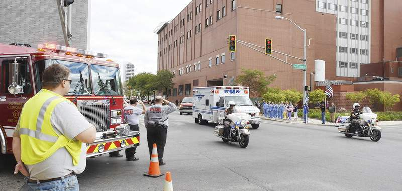 The body of Fort Wayne Fire Department Capt. Eric Balliet, who died Wednesday during a training exercise, is transported Thursday from St. Joseph Hospital to D.O. McComb's Tribute Center on West Main Street. (Cathie Rowand | The Journal Gazette)