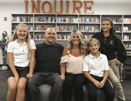A Bishop Luers family, from left to right, Remi Bearman, 12, Heath Bearman, Beth Bearman, Enzo Bearman, 11, and Rica Rodriguez, 17, all of Fort Wayne. (Photos by Michelle Davies | The Journal Gazette)