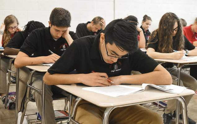 Uriah Vazquez, a freshman at Bishop Luers High School, works on a pretest in world history.