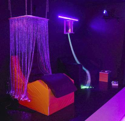 Michelle Davies | The Journal Gazette The vibrating pad sits under fiber-optic light strands in the YMCA sensory room. The lights in the room can be adjusted to each individual.