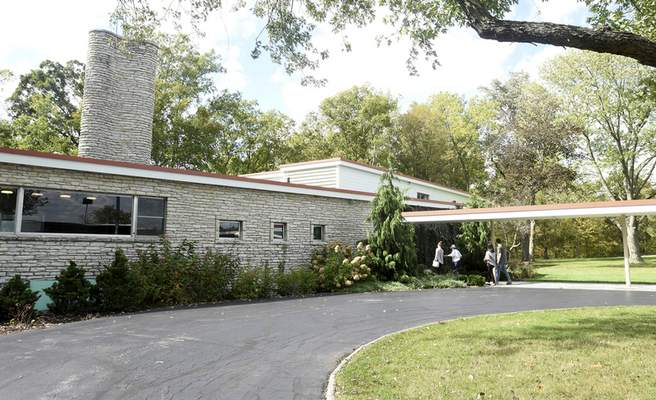 Photos by Rachel Von   The Journal Gazette Guests walk into a house Saturday during the first-ever tour of Fort Wayne's A.C. Wermuth home, designed by Eliel and Eero Saarinen.