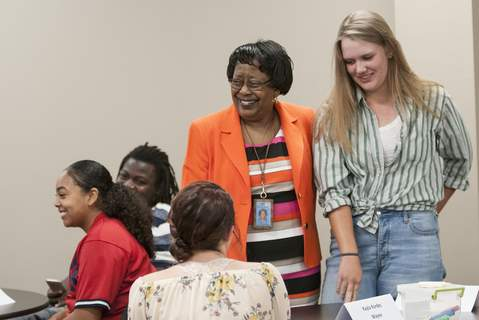 Cathie Rowand | The Journal Gazette FWCS Superintendent Dr. Wendy Robinson talks with students as Wayne High School student Molly Brehm, right, introduces herself at a student advisory council meeting. (CATHIE ROWAND)