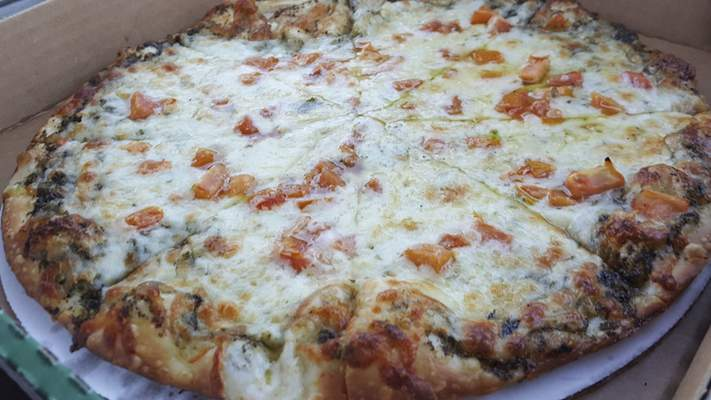 The Smokin' Rose pizza with pest and fresh tomatoes at Puckerbrush Pizza in Payne, Ohio.