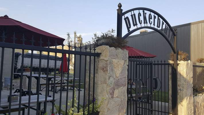The patio area at Puckerbrush Pizza in Payne, Ohio, was very nice with custom made picnic tables and bar tables, and a nifty arching sign at the entryway.