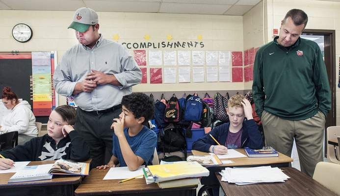Photos by Cathie Rowand | The Journal Gazette TinCaps President Michael Nutter, right, principal of the day at Holland Elementary, and Principal John Ankenbruck  observe Kapree Sisson's fifth-grade class Thursday.