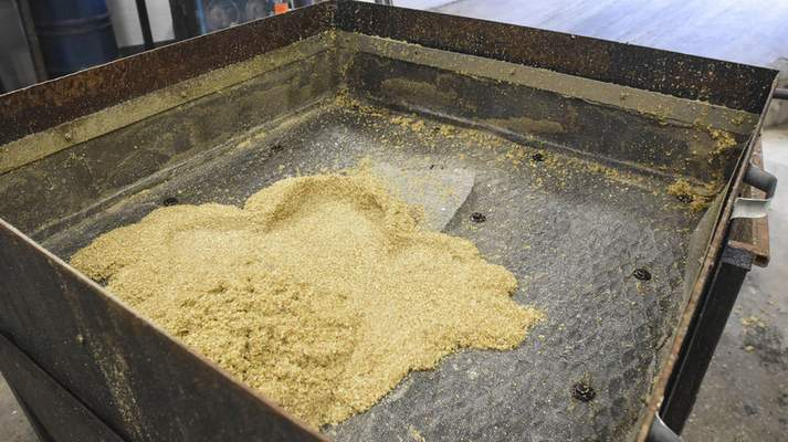 Michelle Davies | The Journal Gazette Spent grain that has been used by Three Rivers Distillery that is then sent to a farm in Markle, Indiana for the cattle.