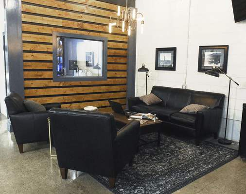 Michelle Davies | The Journal Gazette One of three executive lounge areas at Three Rivers Distillery.