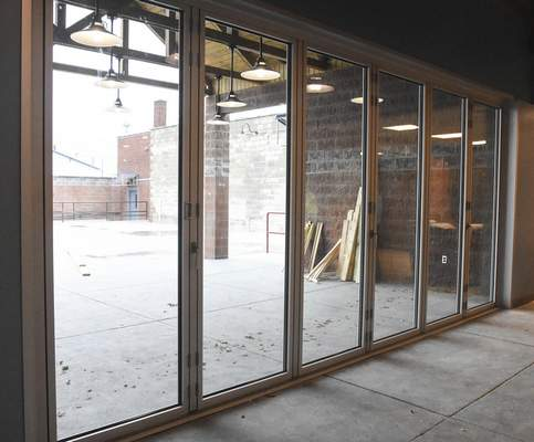 Michelle Davies | The Journal Gazette A wall of doors that will be able to be opened for guests at Three Rivers Distillery to enjoy an open air patio.