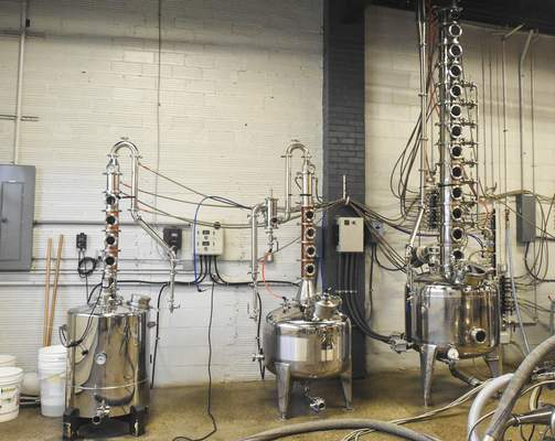 Michelle Davies | The Journal Gazette The finishing stills that are used to make vodka, rum, and bourbon at Three Rivers Distillery.