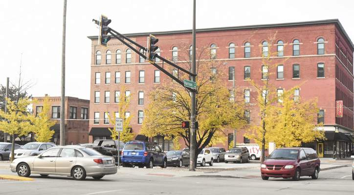 Michelle Davies | The Journal Gazette Local officials are considering where those who currently use the lot at Harrison and Main streets will be able to park their vehicles.