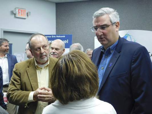 Sherry Slater | The Journal Gazette Gov. Eric Holcomb speaks with guests after outlining his 2018 legislative agenda Friday at Fort Wayne Metals.