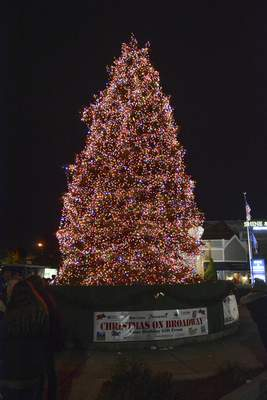 Brett Luke | The Journal Gazette The 40-foot Colorado spruce is lit up with 30,000 lights during Friday's annual  Christmas on Broadway  at Broadway Plaza.